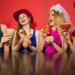 Laughing friends at a hen night drinking cocktails — Stock Photo