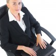 Young businesswoman sitting on her office chair using her notebook — Stock Photo #33447099