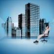 Businessman on swivel chair looking at holographic city — Stock Photo