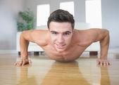 Happy handsome man doing push ups — Stock Photo