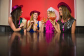 Attractive friends at a hen night drinking cocktails — Stock Photo