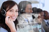 Smiling businesswoman using futuristic interface hologram — Stock Photo