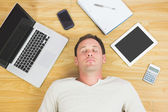 Casual tired man lying on floor — Stock Photo