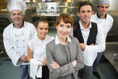 Cute female manager posing with the staff — Stock Photo