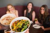 Waiter bringing the salad — Stock Photo