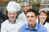 Young manager posing in a kitchen — Foto Stock