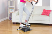 Sporty woman training on step machine — Stock Photo