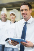 Young restaurant manager holding his tablet — Foto de Stock