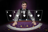 Picture of croupier standing behind holographic cards — Stock Photo