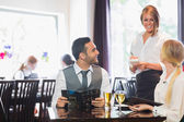 Business people ordering dinner — Stock Photo