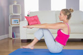 Sporty focused blonde doing core exercise — Stock Photo