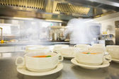Bowls filled with hot soup — Stock Photo