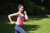 Fit woman running in the sunshine — Stock Photo