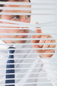 Nice looking businessman spying — Stock Photo