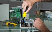Hands repairing hardware with screw driver — Stock Photo