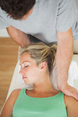 Physiotherapist massaging patients shoulder — Stock Photo