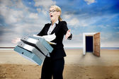 Frustrated businesswoman dropping folders — Stock Photo