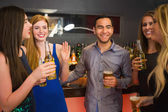 Happy friends holding beers — Stock Photo