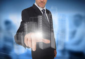 Businessman touching holographic faint city — Stock Photo