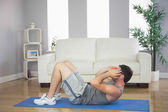 Handsome sporty man doing sit ups — Stock Photo