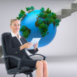 Stock Photo: Composite image of businesswoman sitting on swivel chair with ta