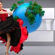Composite image of dancing woman in a red and black dress — Stock Photo