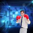 Stock Photo: Businessmwith his boxing gloves ready to fight