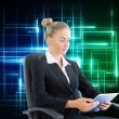Businesswomsitting on swivel chair with tablet — Stock Photo #36156603