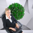 Composite image of businesswoman sitting on swivel chair with laptop — Stock Photo #36157153