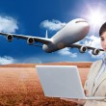 Confident businesswoman holding laptop — Stock Photo