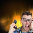 Frustrated computer engineer screaming while on call — Stock Photo #36157897