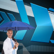 Businessman holding umbrella smiling at camera — Stock Photo
