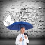 Mature businessman holding an umbrella — Stock Photo