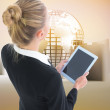 Composite image of businesswoman holding tablet — Stock Photo #36158505