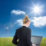 Blonde businesswoman using laptop — Stock Photo #36158777