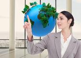 Saleswoman operating touchscreen — Zdjęcie stockowe