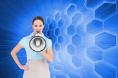 Furious classy businesswoman talking in megaphone — Stock Photo