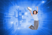 Businesswoman jumping while holding clipboard — ストック写真