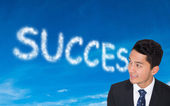 Composite image of smiling asian businessman — Stock Photo