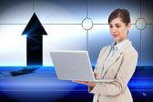 Сonfident businesswoman holding laptop — Stock Photo