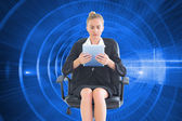 Concentrated chic businesswoman using her tablet — Stock Photo