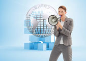 Businesswoman talking on a megaphone — Stock Photo