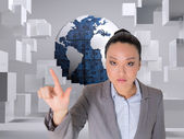 Composite image of unsmiling asian businesswoman pointing — Stock Photo
