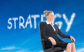 Composite image of businesswoman sitting on swivel chair in blac — Stock Photo