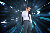 Composite image of unsmiling businessman standing — Stock Photo