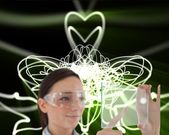 Doctor in protective glasses holding virtual screen — Stock Photo