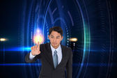 Composite image of stern asian businessman pointing — Stock Photo