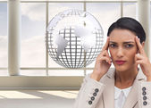 Businesswoman putting her fingers on her temples — Stock Photo