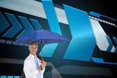 Businessman holding umbrella smiling at camera — Stock Photo
