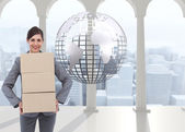 Smiling businesswoman carrying cardboard boxes — Stock Photo